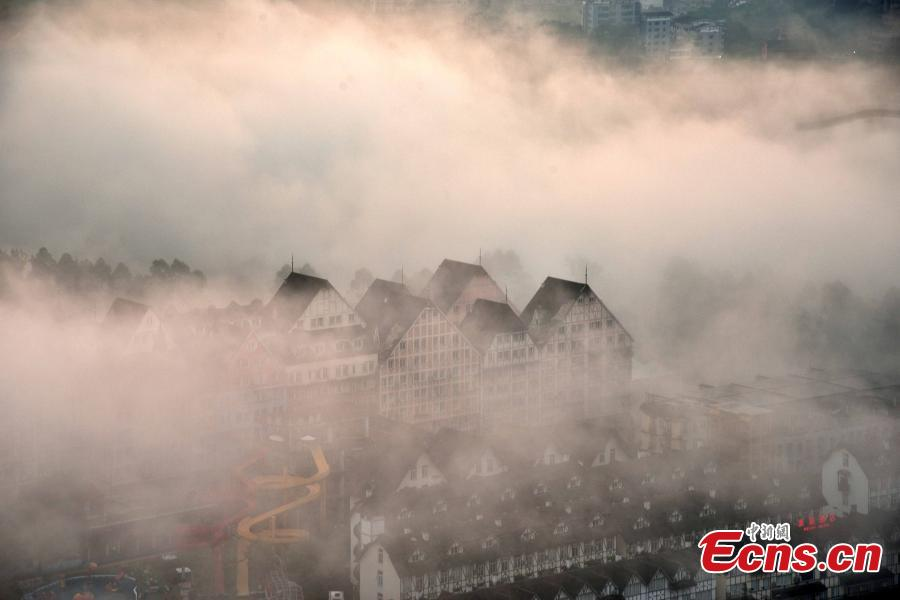 <?php echo strip_tags(addslashes(Fog shrouds buildings in the Wine Town, near the Yangtze River, in Fuling District, Chongqing Municipality, June 2, 2019. (Photo: China News Service/Shi Wei))) ?>