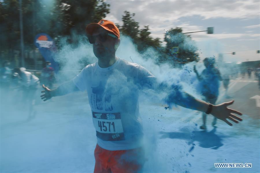Participants run through colored powder during the annual color run in Moscow, Russia, June 2, 2019. (Xinhua/Evgeny Sinitsyn)
