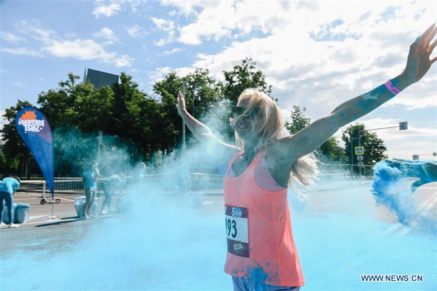 A participant runs through colored powder during the annual color run in Moscow, Russia, June 2, 2019. (Xinhua/Evgeny Sinitsyn)