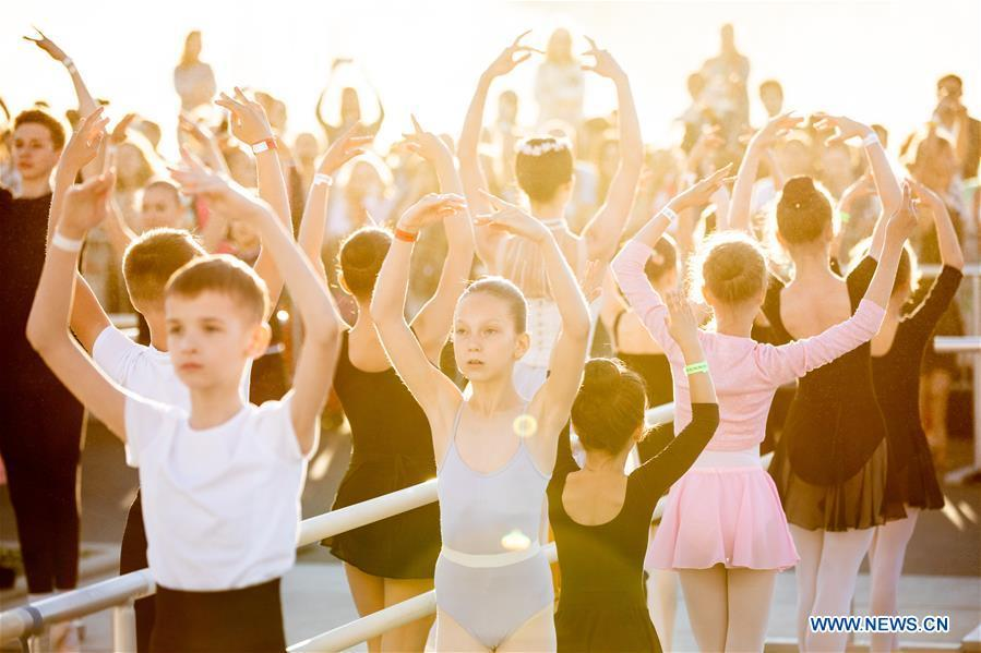 Ballet dancers take part in a ballet master class by Nikolay Tsiskaridze during The World Ballet Holidays Festival, in Moscow, Russia, on June 1, 2019. The World Ballet Holidays Festival is held from May 31 to June 2 at VDNH exhibition complex in Moscow. One of the highlights of the festival is an outdoor ballet class conducted by ballet dancer Nikolay Tsiskaridze. (Xinhua/Maxim Chernavsky)