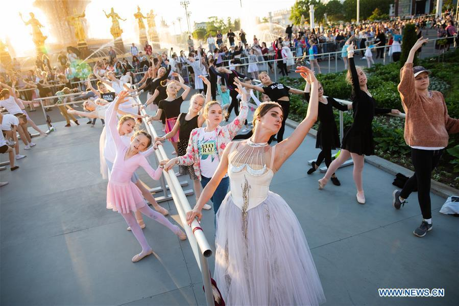 Dancers take part in a ballet master class by Nikolay Tsiskaridze during The World Ballet Holidays Festival in Moscow, Russia, on June 1, 2019. The World Ballet Holidays Festival is held from May 31 to June 2 at VDNH exhibition complex in Moscow. One of the highlights of the festival is an outdoor ballet class conducted by ballet dancer Nikolay Tsiskaridze. (Xinhua/Maxim Chernavsky)