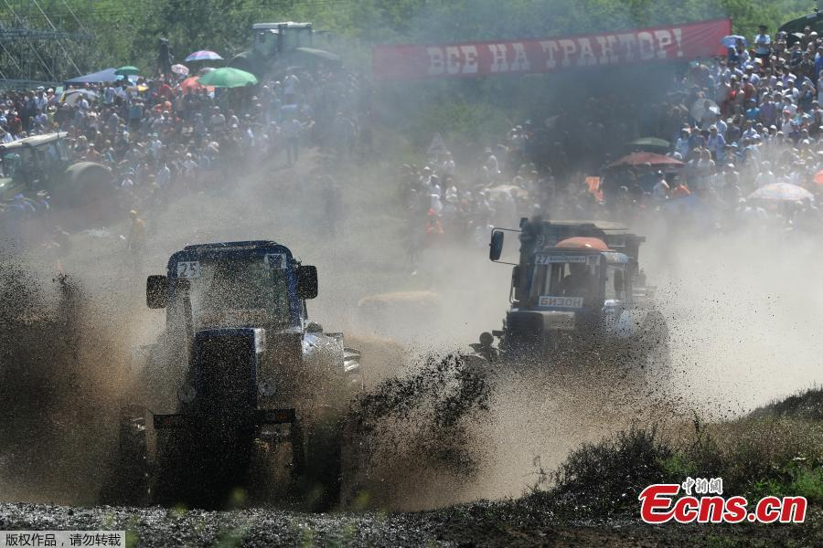 Participants attend a regional?tractor?racing competition Bizon-Track-Show outside of Rostov-on-Don, Russia June 2, 2019.(Photo/Agencies)