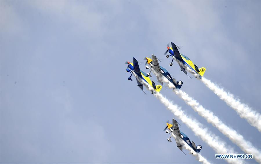 Enthusiasts in air sports give an aerobatic show during the opening of the 11th Air Sports Culture and Tourism Festival in Anyang, central China\'s Henan Province, June 3, 2019. The event kicked off Monday in the city of Anyang, attracting air sports fans from home and abroad. (Xinhua/Li Jianan)