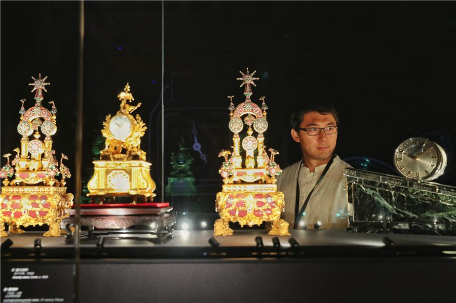 A visitor views top-tier timepieces at the exhibition. (Photo provided to China Daily)