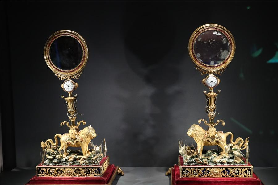 <?php echo strip_tags(addslashes(A pair of clocks with mirrors and lion-shape decorations are among six timepieces benefiting from the cooperation between the Palace Museum and Cartier. (Photo provided to China Daily)