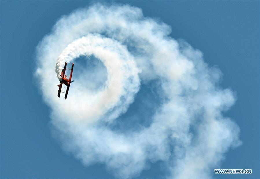 An enthusiast in air sports gives an aerobatic show during the opening of the 11th Air Sports Culture and Tourism Festival in Anyang, central China\'s Henan Province, June 3, 2019. The event kicked off Monday in the city of Anyang, attracting air sports fans from home and abroad. (Xinhua/Li Jianan)