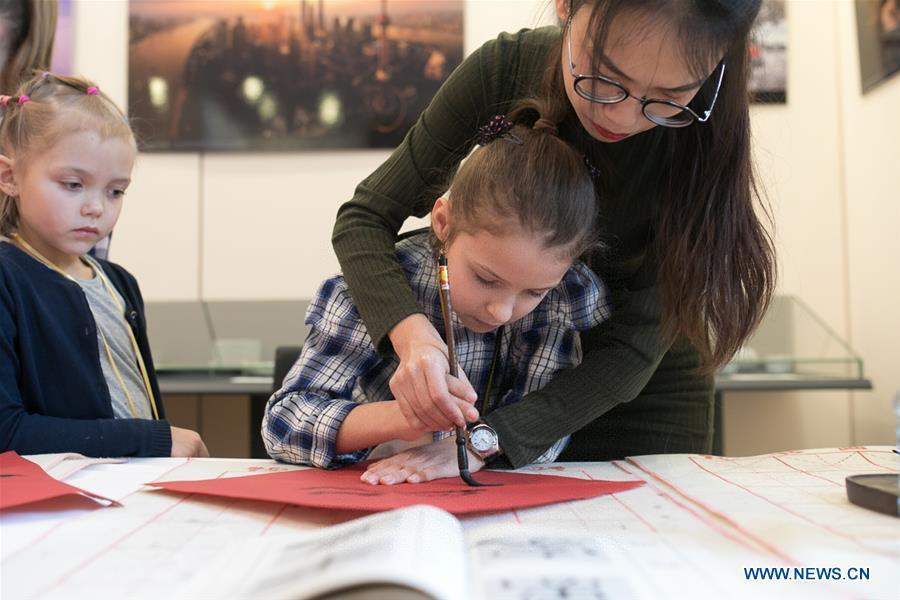 A Russian girl learns Chinese calligraphy at a Spring Festival celebration held by the China Culture Center in Moscow, Russia, Feb. 2, 2019. (Xinhua/Bai Xueqi)