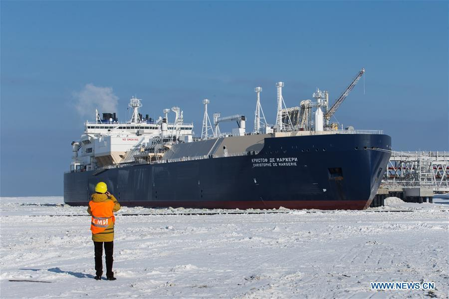 A journalist captures images of the Christophe de Margerie icebreaking LNG (liquefied natural gas) carrier, which serves the Yamal LNG project, at the Port of Sabetta in the Autonomous Okrug of Yamlo-Nenets, Russia, March 30, 2017. (Xinhua/Bai Xueqi)