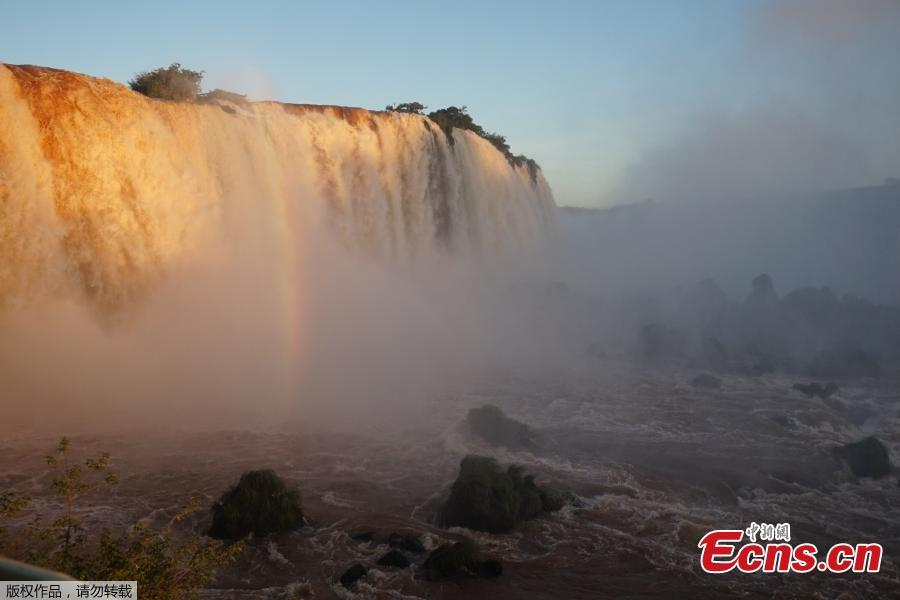 Picture of the Iguacu falls -considered as one of the largest waterfalls in the world- as seen from the Brazilian side on the border with Argentina, near Foz do Iguacu, on June 4, 2019. The quantity of water falling from the Iguacu falls at the border between Argentina and Brazil has doubled these last few days following heavy rains in the region. While the average flow rate of the falls is usually 1,5 million liters of water per second, the currently rate is at 3 million. (Photo/Agencies)