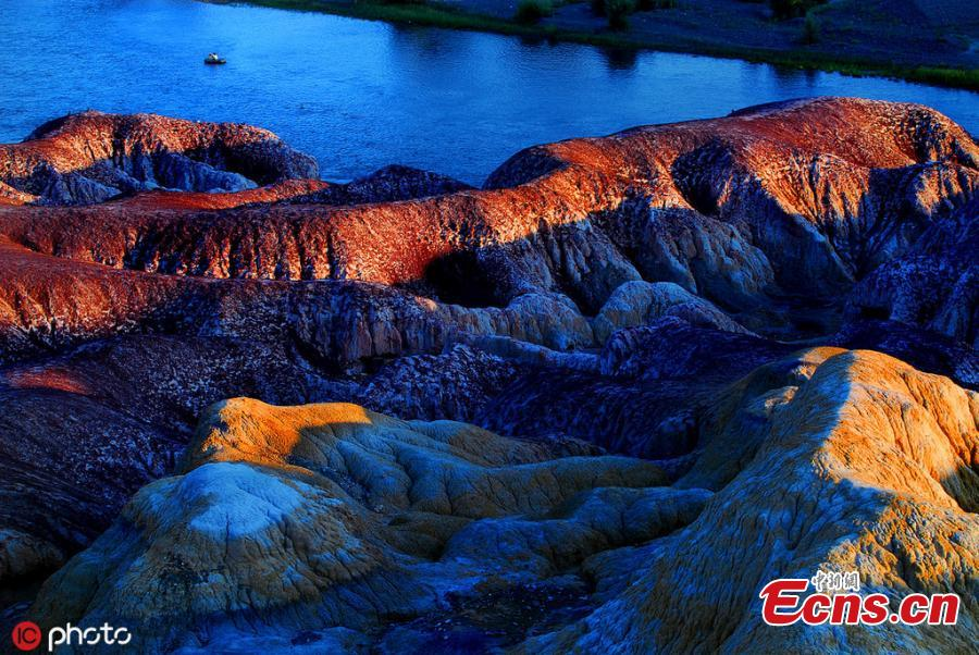 The photo taken on June 5, 2019 shows Wucaitan, also known as the Rainbow Beach in Burqin county, Altay Prefecture, northwest China\'s Xinjiang Uyghur Autonomous Region. The beach is known for its unique landforms created by years of wind and water erosion. (Photo/IC)