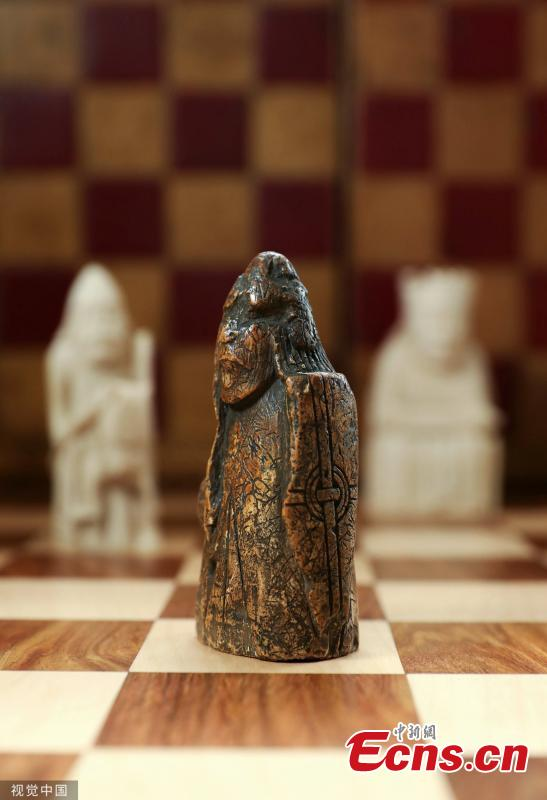 A 900-year-old chess piece was identified after missing for almost 200 years. A family in Scotland's capital city of Edinburgh kept the chessman in a drawer since 1964 with no details about the piece. It was purchased for a few pounds by the family's grandfather, an antique dealer, without knowing its value at the time, according to the BBC. The artifact was carved from walrus ivory during the 12th century and comes from the Viking era. (Photo/VCG)