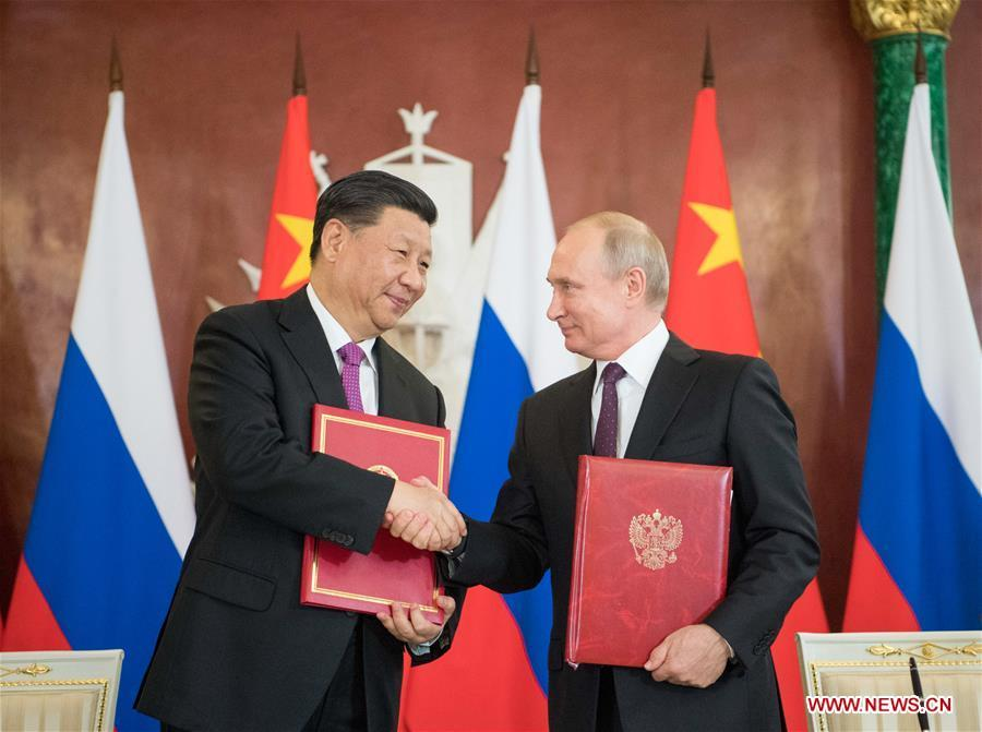 Chinese President Xi Jinping (L) and his Russian counterpart Vladimir Putin sign the statements on elevating bilateral ties to the comprehensive strategic partnership of coordination for a new era and on strengthening contemporary global strategic stability, and witness the signing of a number of cooperation documents, after their talks in Moscow, Russia, June 5, 2019. Xi Jinping held talks with Vladimir Putin at the Kremlin in Moscow on Wednesday. (Xinhua/Li Xueren)