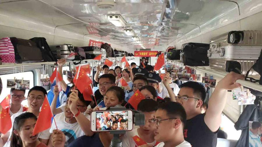 Students set off to Alihe for the national college entrance examination, known as the gaokao, on Wednesday. (Photo provided to chinadaily.com.cn)