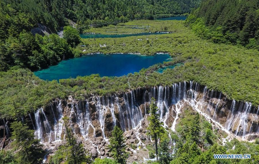 Aerial photo shows the scenery of the Nuorilang Waterfall in the Jiuzhaigou National Park in southwest China\'s Sichuan Province, June 5, 2019. Due to damages caused by the magnitude-7.0 earthquake that hit here on Aug. 8, 2017, the park has been temporarily closed since July 2018 for renovation. (Xinhua/Xue Yubin)
