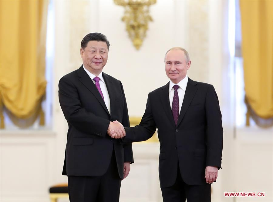 Chinese President Xi Jinping (L) shakes hands with his Russian counterpart Vladimir Putin while posing for photos ahead of their talks in Moscow, Russia, June 5, 2019. Xi Jinping held talks with Vladimir Putin at the Kremlin in Moscow on Wednesday. (Xinhua/Ding Haitao)
