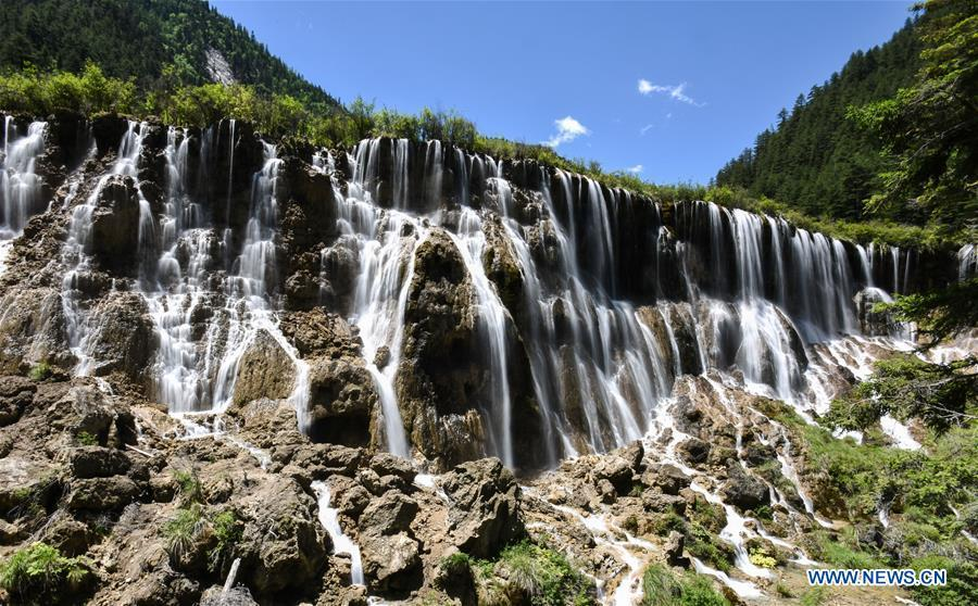Photo shows the scenery of the Nuorilang Waterfall in the Jiuzhaigou National Park in southwest China\'s Sichuan Province, June 5, 2019. Due to damages caused by the magnitude-7.0 earthquake that hit here on Aug. 8, 2017, the park has been temporarily closed since July 2018 for renovation. (Xinhua/Meng Dingbo)