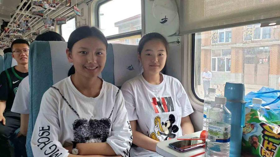 Two students set off to Alihe for the national college entrance examination, known as the gaokao, on Wednesday. (Photo provided to chinadaily.com.cn)