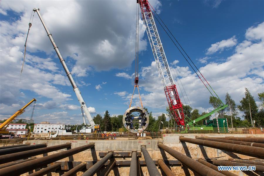Cranes lift components of Tunnel Boring Machine (TBM) in Moscow, capital of Russia, June 3, 2018. Since August 2017, China Railway Construction Corporation Limited (CRCC) has been building a 4.6-km section and three stations on the \