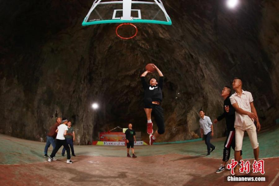 A view of a basketball court built inside a Karst cave in Xinchun Village, Nayong County, Guizhou Province. The basketball court was built with governmental subsidies as well as donations from local residents. It opened last December after it was equipped with an auditorium. (Photo: China News Service/Han Xianpu)
