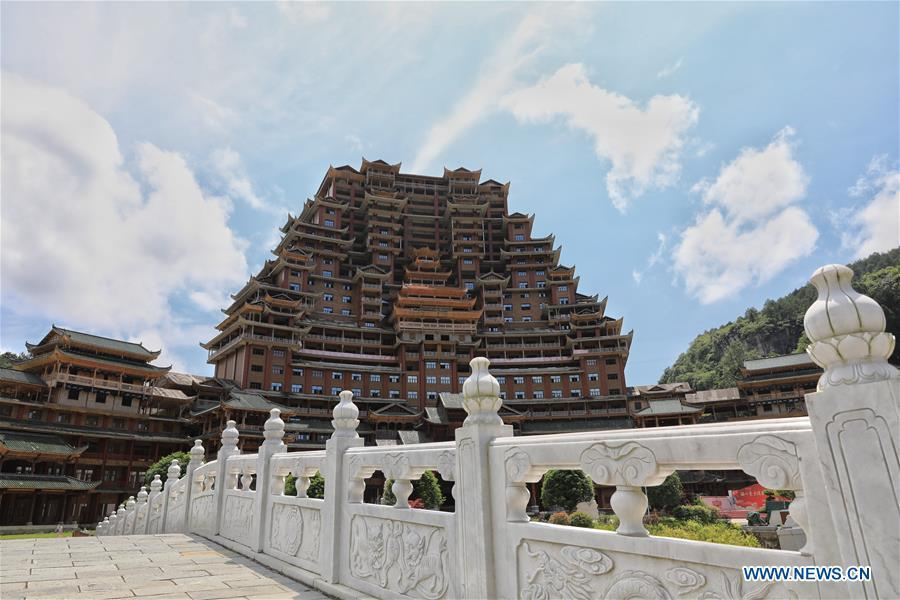 A wooden building of Shui ethnic group is seen in Yingshan Town of Dushan County, southwest China\'s Guizhou Province, June 7, 2019. The 24-story, 99.9-meter-high traditional Shui-style wooden building in Dushan is of \