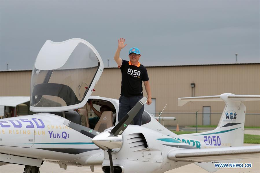 Zhang Bo waves to family members and friends after landing at an airport in Chicago, the United States, on June 9, 2019. After flying 68 days and making 50 stops, 57-year-old Bo Zhang completed his second around-the-world flight and landed in Chicago on Sunday morning. On April 2, Zhang kicked off the flight in the same airport in Chicago. In 68 days, he flied through 21 countries in three continents and over three oceans, with total mileage reaching 41,000 kilometers. (Xinhua/Wang Ping)