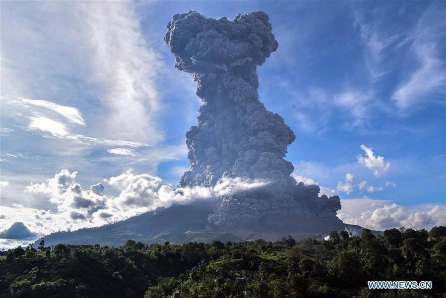 The photo taken on June 9, 2019 shows Mount Sinabung spewing thick ash in Karo, North Sumatra, Indonesia. A column of thick ash was spewed seven km high to the sky from the crater of Mount Sinabung volcano in Sumatra Island of western Indonesia on Sunday, the country\'s national volcanology agency said. (Xinhua/Anto Sembiring)