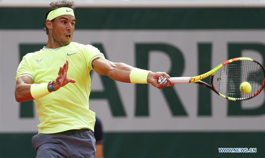Rafael Nadal of Spain competes during the men\'s singles final with Dominic Thiem of Austria at French Open tennis tournament 2019 at Roland Garros, in Paris, France on June 9, 2019. (Xinhua/Han Yan)