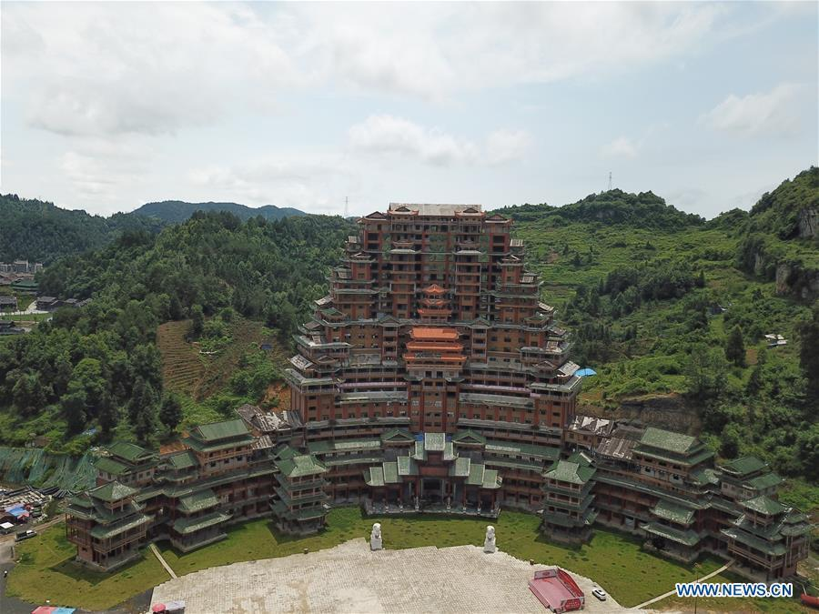 Aerial photo taken on June 7, 2019 shows a wooden building of Shui ethnic group in Yingshan Town of Dushan County, southwest China\'s Guizhou Province. The 24-story, 99.9-meter-high traditional Shui-style wooden building in Dushan is of \