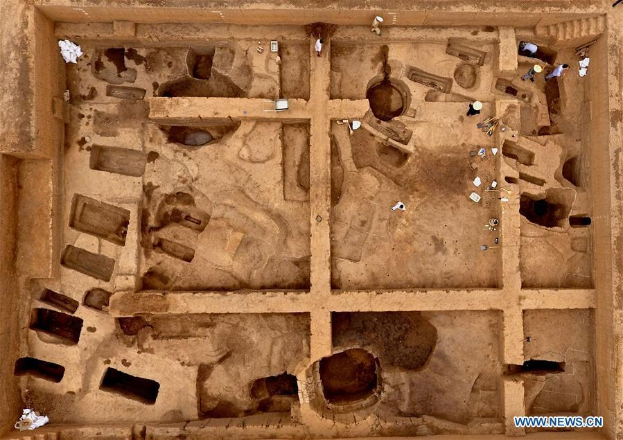 Aerial photo taken on June 5, 2019 shows the family tomb of bronzeware artisans of the Shang Dynasty in Anyang, central China\'s Henan Province. Archaeologists in central China\'s Henan Province said they have identified 42 tombs unearthed since 2017 to be a family tomb of bronzeware artisans dating back over 3,000 years. (Xinhua/Li An)