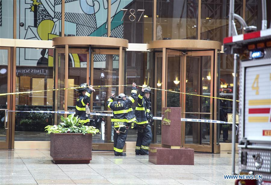 Fire fighters enter the building where a helicopter crashed in Manhattan, New York, the United States, June 10, 2019. One person was killed after a helicopter crashed onto the roof of a skyscraper in Midtown Manhattan of New York City Monday afternoon, according to media reports. (Xinhua/Wang Ying)