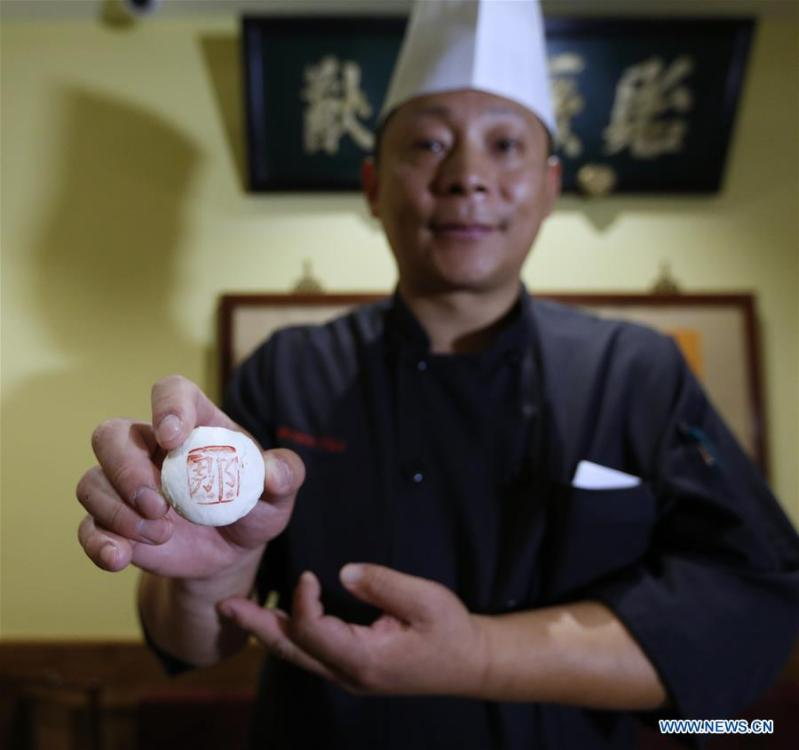 Tian Yong, Executive Chef of Bistro Na\'s, shows Na\'s White Crisp at Bistro Na\'s in Temple City, Los Angeles, the United States, on June 7, 2019. Bistro Na\'s in Los Angeles made headlines this week with the announcement that it had been awarded a coveted Michelin Star by the famed Michelin Restaurant Guide. This special ranking broke Michelin\'s 10-year absence from Los Angeles, and made Bistro Na\'s the only Chinese restaurant in Southern California to be so honored. (Xinhua/Li Ying)