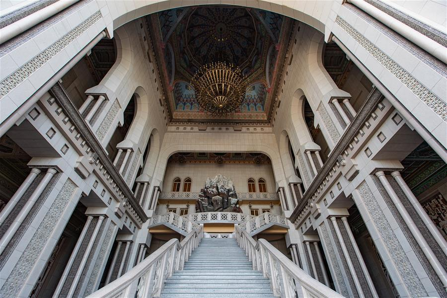 Photo taken on April 14, 2019 shows a stairway at the entrance of the Kohi Navruz (Navruz Palace) in Dushanbe, Tajikistan. The building has 12 halls, each of which is made in a unique style. (Xinhua/Bai Xueqi)