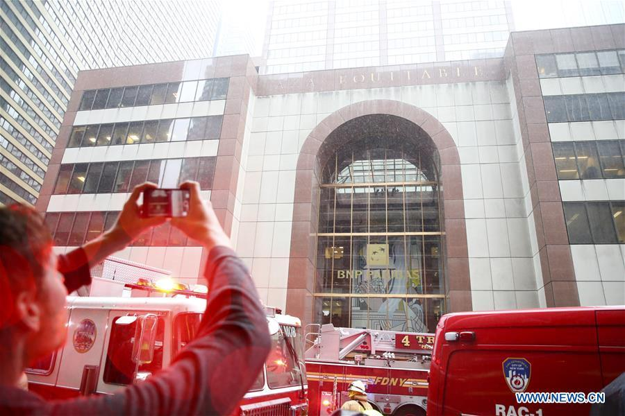 A journalist takes video of the building where a helicopter crashed in Manhattan, New York, the United States, June 10, 2019. One person was killed after a helicopter crashed onto the roof of a skyscraper in Midtown Manhattan of New York City Monday afternoon, according to media reports. (Xinhua/Wang Ying)
