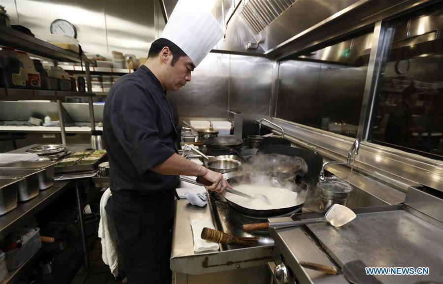 A chef works at the kitchen of Bistro Na\'s in Temple City, Los Angeles, the United States, on June 7, 2019. Bistro Na\'s in Los Angeles made headlines this week with the announcement that it had been awarded a coveted Michelin Star by the famed Michelin Restaurant Guide. This special ranking broke Michelin\'s 10-year absence from Los Angeles, and made Bistro Na\'s the only Chinese restaurant in Southern California to be so honored. (Xinhua/Li Ying)