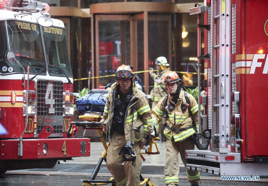 Rescuers walk out of the building where a helicopter crashed in Manhattan, New York, the United States, June 10, 2019. One person was killed after a helicopter crashed onto the roof of a skyscraper in Midtown Manhattan of New York City Monday afternoon, according to media reports. (Xinhua/Wang Ying)