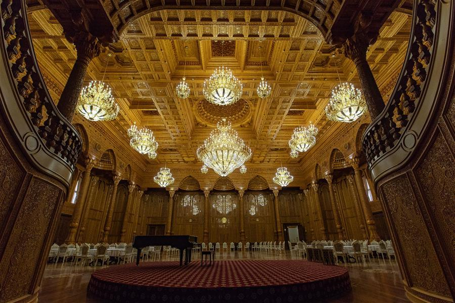 Photo taken on April 14, 2019 shows a banquet hall in the Kohi Navruz (Navruz Palace) in Dushanbe, Tajikistan. The building has 12 halls, each of which is made in a unique style. (Xinhua/Bai Xueqi)