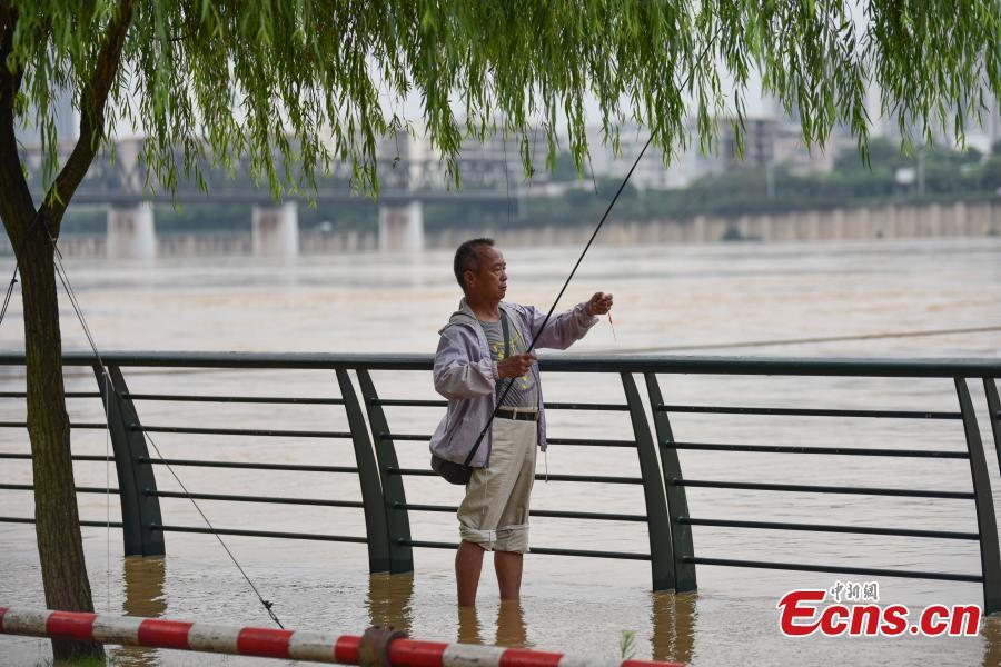 A man fishes near the Liujiang River after heavy rainfall upstream in Liuzhou City, Southwest China's Guangxi Zhuang Autonomous Region, June 10, 2019. (Photo: China News Service/Wang Yizhao)