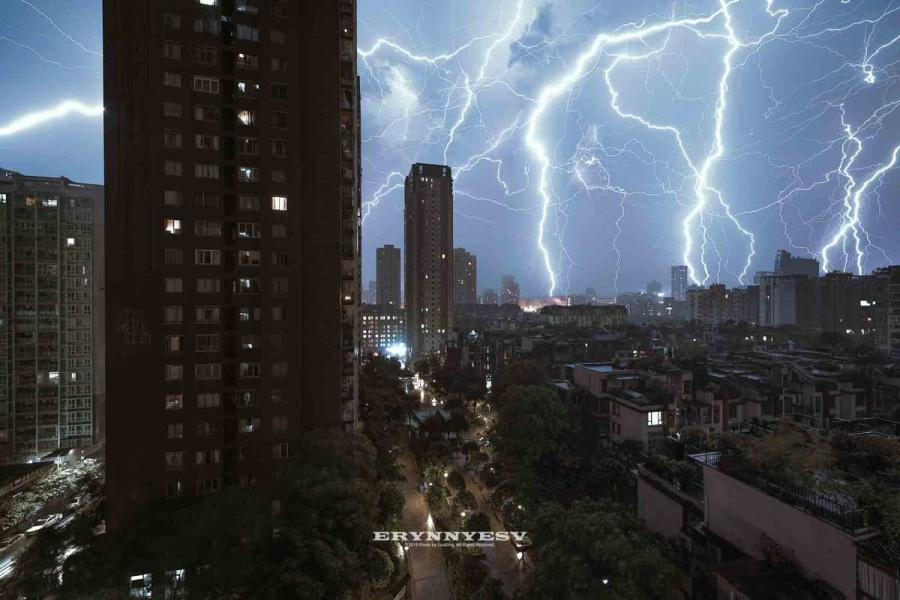 """The lightning strike caught by Luo Xing in Chongqing. (Photo provided to chinadaily.com.cn) Summer is the best season for Luo Xing, a photographer in Southwest China's Chongqing, who loves shooting lightning.  """"I feel so excited when dark clouds gather and strong wind blows,"""" he said. """"It means a thunderstorm is coming.""""  Chongqing usually sees many thunderstorms in summer time. Luo has shot many images of lightning over the city landscape.  The business management major learned photography by himself and now he works for Getty Images China on contract.  Surrounded by two rivers and mountains, Chongqing attracts many urban landscape photographers with its unique city view and geography."""