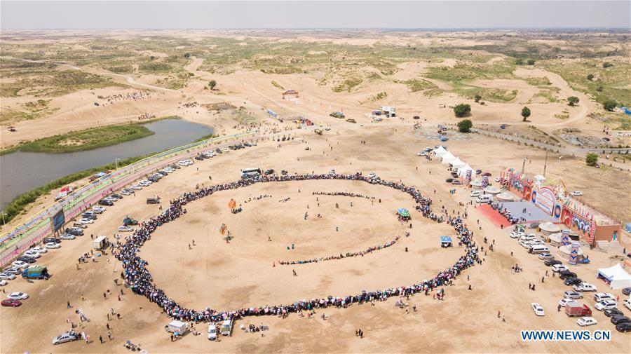 Aerial Photo taken on June 10, 2019 shows the scene a desert Nadam Fair held in Naiman Banner, Tongliao City, north China\'s Inner Mongolia Autonomous Region. (Xinhua/Peng Yuan)