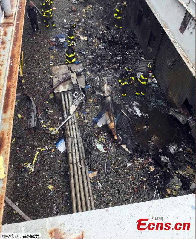 The site of a helicopter crash, Monday, June 10, 2019, in Manhattan, New York. The New York City Fire Department says the pilot of a helicopter that crashed on a Manhattan skyscraper rooftop has died.(Photo/Agencies)