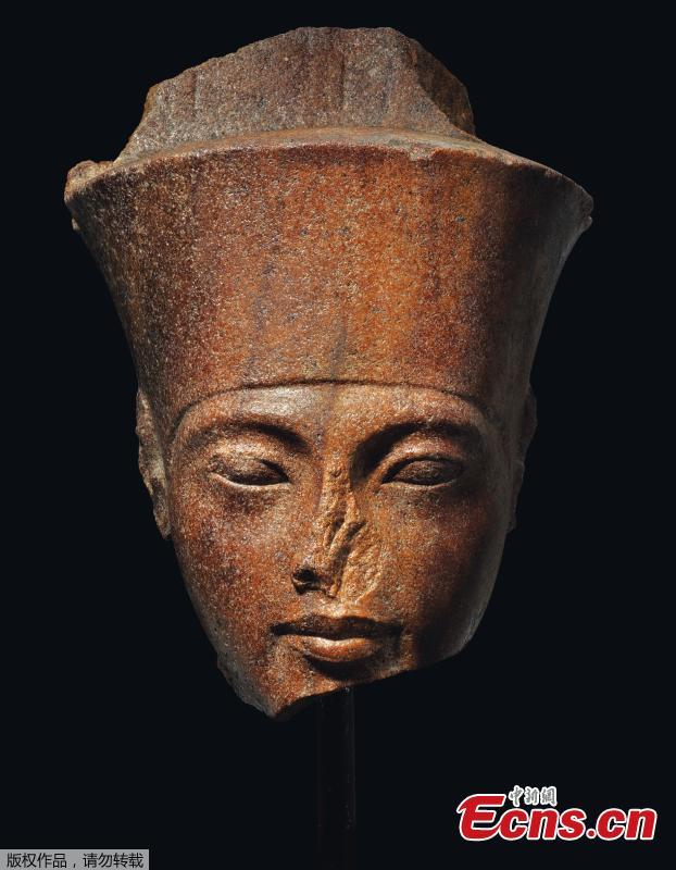 Photo shows an Egyptian head of the God Amen with the features of the Pharaoh Tutankhamen circa 1333-1323 B.C., which is up for auction at Christie\'s. (Photo/Agencies)