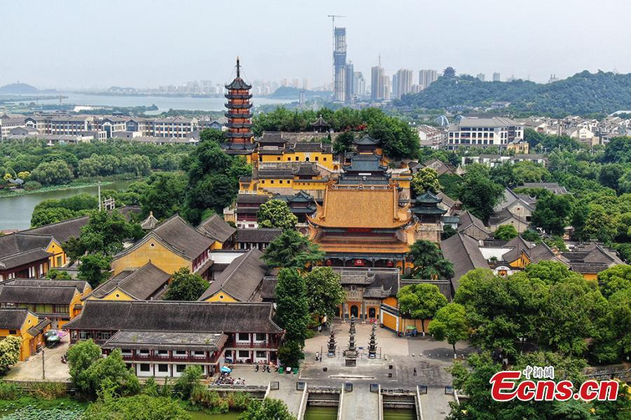 An aerial view of the Jinshan Park in Zhenjiang City, Jiangsu Province, June 11, 2019. The park is home to Jinshan Temple, a famous Buddhist temple built on a mountain to the south of the Yangtze River. (Photo: China News Service/Yang Bo)