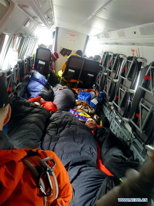 Climbers injured during the avalanche in Mount Qomolangma rest on a rescue plane, April 26, 2015. (Xinhua/Li Liang)