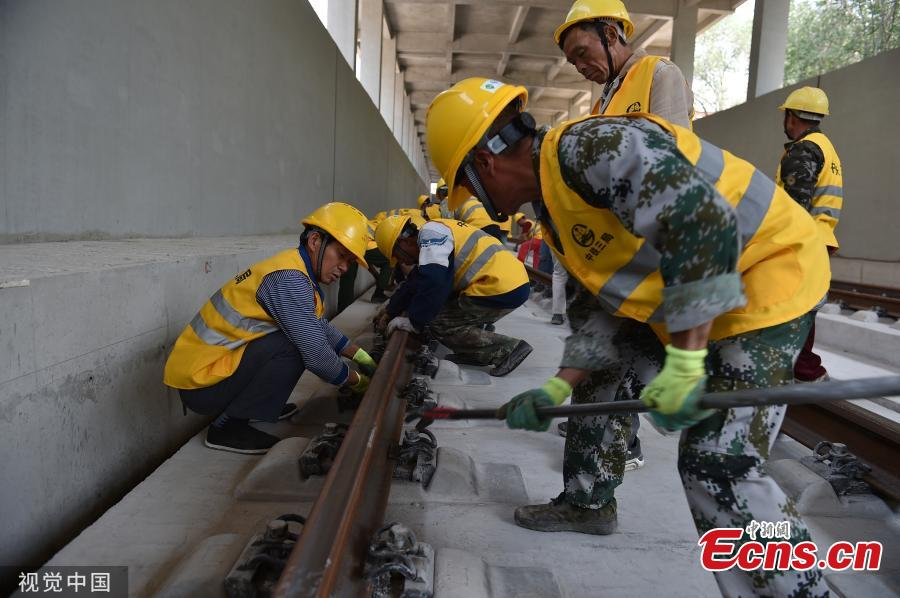 The entire track-laying construction for the Beijing-Zhangjiakou high-speed railway was completed on June 12, 2019. The railway is 174 kilometers long, which is an important traffic guarantee measure for the Beijing Winter Olympic Games in 2022. After completion, the time from Beijing to Zhangjiakou by train will be shortened from three hours to less than one hour, which is of great significance for promoting the coordinated development of Beijing, Tianjin and Hebei and also connecting the western region.(Photo/VCG)