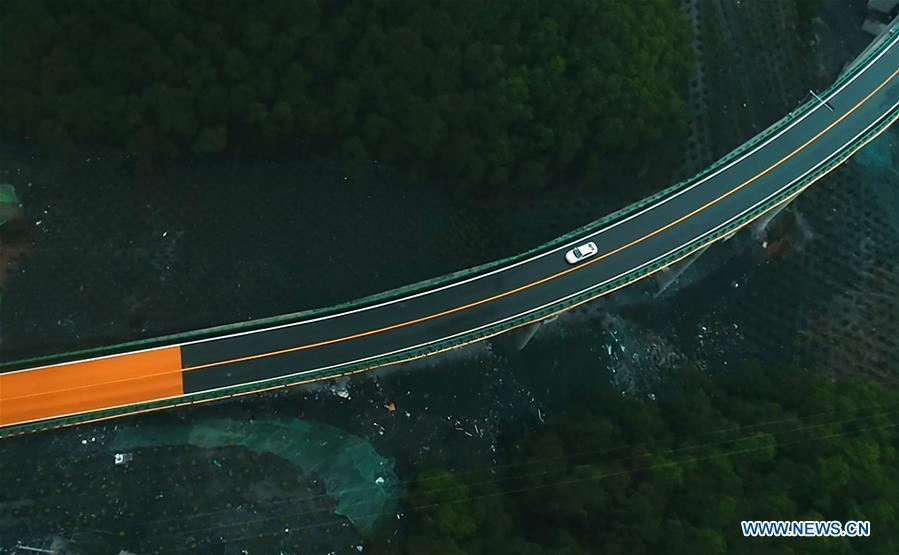Aerial photo taken on June 11, 2019 shows a car running on the highway linking Zhalonggou with Nianbo Township in northwest China\'s Qinghai Province. A 50.79-km highway linking Zhalonggou and Nianbo Township in Qinghai Province opened to the traffic on Tuesday. (Xinhua/Zhang Hongxiang)