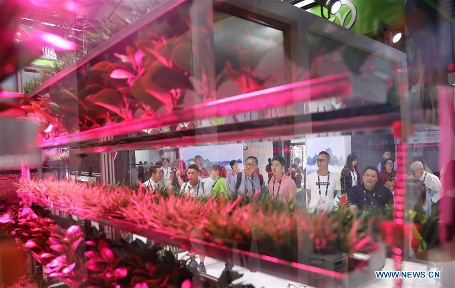 Visitors view a vegetable planting system during the 2019 Consumer Electronics Show (CES) Asia in east China\'s Shanghai, June 11, 2019. The 2019 Consumer Electronics Show (CES) Asia kicked off on Tuesday in Shanghai. The three-day exhibition showcased the latest achievements in 5G technology, artificial intelligence, augmented/virtual reality and vehicle technology. (Xinhua/Fang Zhe)