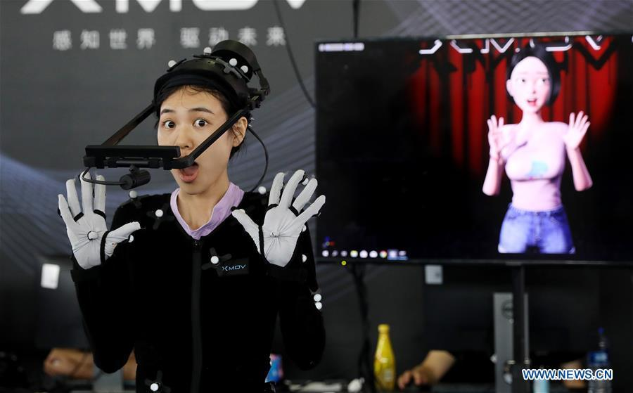 A staff member demonstrates a gesture capturing system during the 2019 Consumer Electronics Show (CES) Asia in east China\'s Shanghai, June 11, 2019. The 2019 Consumer Electronics Show (CES) Asia kicked off on Tuesday in Shanghai. The three-day exhibition showcased the latest achievements in 5G technology, artificial intelligence, augmented/virtual reality and vehicle technology. (Xinhua/Fang Zhe)