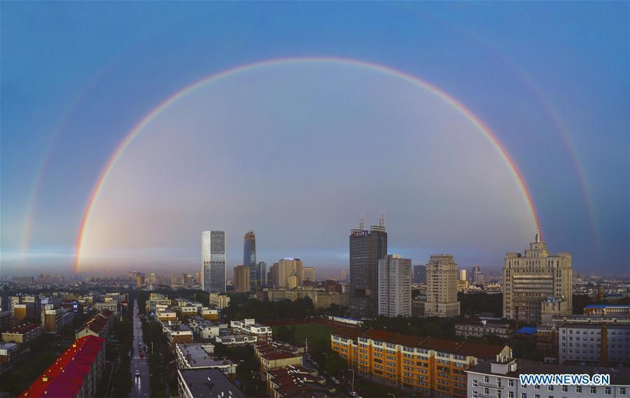 Stitched aerial photo taken on June 11, 2019 shows double rainbow arching across Changchun City, northeast China\'s Jilin Province. A double rainbow brightened the sky over Changchun City after a strong rainfall hit the city. (Xinhua/Xu Chang)