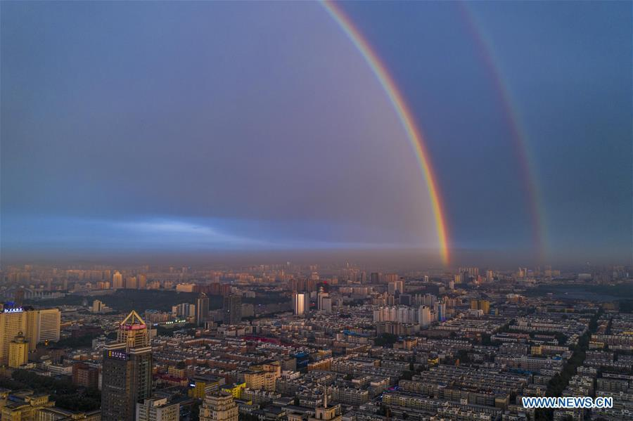Aerial photo shows double rainbow arching across Changchun City, northeast China\'s Jilin Province, on June 11, 2019. A double rainbow brightened the sky over Changchun City after a strong rainfall hit the city. (Xinhua/Xu Chang)
