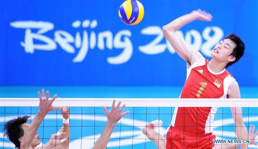 Bian Hongmin of China competes during the men\'s volleyball quarterfinal match against Brazil at the Olympic Games in Beijing, capital of China, Aug. 20, 2008. This year marks the 70th anniversary of the founding of the People\'s Republic of China (PRC). On April 5, 1959, Rong Guotuan won the champion of the men\'s singles event at the 25th ITTF World Table Tennis Championships in Dortmund, Germany, becoming China\'s first ever world champion. Chinese players have made more achievements during the 60 years since then. (Xinhua/Zhao Zhongzhi)